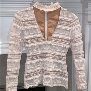 Blouse with cut out in front